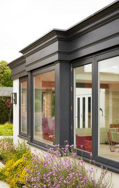 Orangery Extension and Loggia in Westbury Black - Westbury Garden Rooms room black Orangery Extension and Loggia in Westbury Black - Westbury Garden Rooms Garden Room, Garden Room Extensions, Bay Window Exterior, House Exterior, Flat Roof Extension, House Outside Design, Window Trim Exterior, Sunroom Designs, Victorian House Interiors