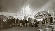 Crowds watching a Hollywood premiere at Grauman's Chinese Theatre from the roof top view of Hotel Roosevelt's Cinegrill.