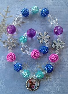 Frozen Elsa and Anna Stretch Necklace and by GraceandGreenBeans, $15.99. Also check out my shop for more ideas. www.partiesandfun.etsy.com