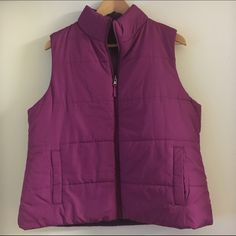 Sleeveless Vest A fuchsia sleeveless vest with regular lining. It has two pockets and zips to the neck. Old Navy Jackets & Coats Vests