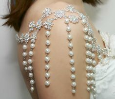 Surprisingly pretty. I like the dangling pearls and how it showcases the shoulders in an elegant way.