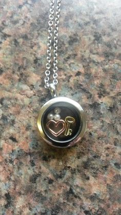 Silver Mini Sout Hill Designs Locket with Rose Gold Open Heart charm, 3 pack of Vanilla Pearls, Gold key charm, if you want one of your own you can order yours from me at http://www.southhilldesigns.com/andreabrindley