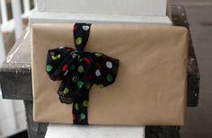 Wrap a dollar store scarf around kraft paper gift wrap