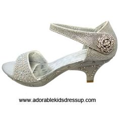 Elegant silver high heel shoes with a Velcro ankle strap for a comfortable fit.  Sizes 9-4 for toddlers and children.