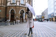 Fashion blogger Veronika Lipar of Brunette From Wall Street sharing her weekend style on the streets of Ljubljana