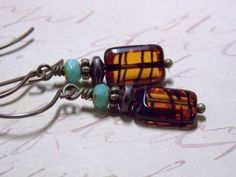 Vintaj Antique Brass ear wires dangling with... ~Topaz Striped Czech rectangular beads ~Turquoise Czech beads ~Antique Brass accents Measures 1.5 inches