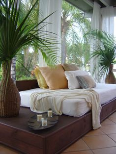 Love the airy sheer drapery panels in this tropical sunroom.  www.budgetblinds.com/walnutcreek
