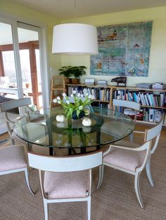 Round glass table with fun chairs.