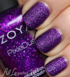 Zoya Fall 2013 PixieDust Nail Polish Swatches // Zoya Carter is a bold royal purple with fuchsia metallic glitter. The smoky blackened base peeks out through the glitter, grounding the color and giving it a more fall feel.