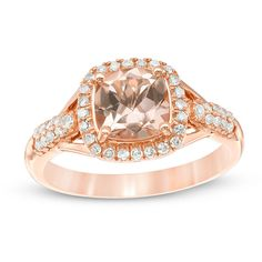 A luxe look, this fabulous gemstone and diamond ring is sure to be treasured. Crafted in precious 10K rose gold, this dazzling design highlights a glittering 7.0mm cushion-shaped soft-pink morganite center stone wrapped in a complementary frame of sparkling diamonds. Glistening filigree cutouts decorate the dimensional center setting, while two rows of diamonds adorn the ring's brilliant shank to complete the style. Captivating with 1/4 ct. t.w. of diamonds, this ring is polished to ...