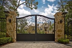 Impressive Wrought Iron Gates Defining Landscaping Designs: Driveway Paver Patterns With Wrought Iron Gates And Iron Fence Also Outdoor Lighting For Driveway Gates With Front Yard Landscape And Exterior Paint Ideas ~ parsegallery.com Exterior Design Inspiration
