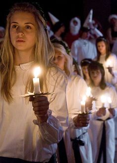 Fun Facts for Kids All About Christmas in Sweden - image of a Girl in the Lucia Procession on Saint Lucia Day