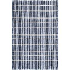 Test drive this rug in your space.Order a swatch by adding it to your cart.Part of our Bunny Williams collection, this delicately striped, navy indoor/outdoor rug was inspired by an antique rug sample from the designers own personal collection. Due to the handmade nature of this area rug, variations in color are expected.Made of 100% PET, a polyester fiber made from recycled plastic bottles.