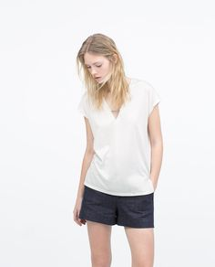 Image 1 of T-SHIRT WITH METAL DETAIL from Zara