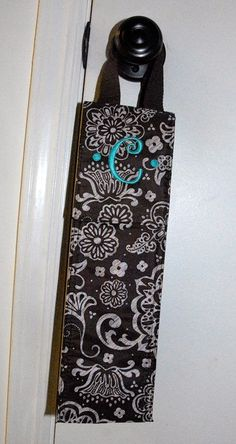 The new perfect bottle thermal from thirty one in brown woodblock floral with aqua embroidery.