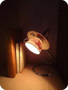 Cool or what?!   Recycled flower design teacup into a reading lamp.