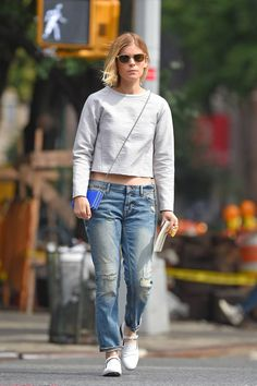 The Takeaway: A cropped sweatshirt, jeans and a cross-body bag is perfect for a day in the city.   - HarpersBAZAAR.com