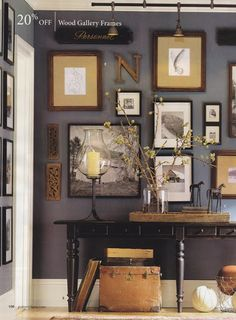 I love this collage wall - and how things are hung from the top.  Great for tall ceilings.
