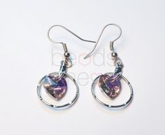 Lovely dangling earrings made with Swarovski Elements Xilion Heart pendant.