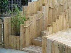 stairs, walls and retaing walls made of timber sleepers