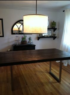 Finished reclaimed barn wood dining table with modern stainless steel legs