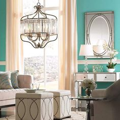 Featuring a transitional design with contemporary crystal shapes and curved metal frame, this breathtaking chandelier is an exquisite addition to any space.