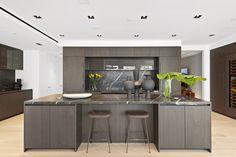 Big City Digs: Urban Loft With Eclectic Lighting Loft Kitchen, Modern Kitchen Island, Modern Kitchen Design, Brown Bar Stools, Stone Backsplash, Urban Loft, Luxury Loft, Interior Decorating, Interior Design