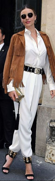 Who made  Miranda Kerr's brown suede fringe jacket, gold belt, and black sandals that she wore in Paris