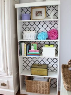 If your shelf houses objects in solid tones, try an unexpected print behind them.