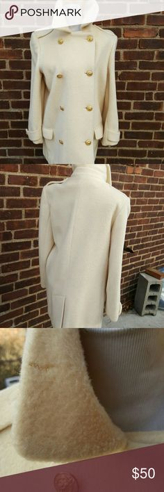Fab vintage ivory peacoat L-XL I wore this coat last winter and can tell you that it is extremely warm. There are some more bites besides the one shown in the picture but I do not believe they affect the wear. I am an XL or 1X and this fits me. It measures 16 inches shoulder to shoulder and 21 inches under the arms. It Is Well with an acetate lining and is made by George David fashions. Because of the weight this may not be bundled to exceed 5 pounds. It has a size 10 label but is much…