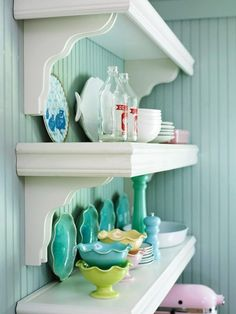 Lovely: open shelving, pretty dishes and perfectly aqua bead board.  Pretty: decoupage a vanity or dresser with some summery paper. Add a quirky stool in gr