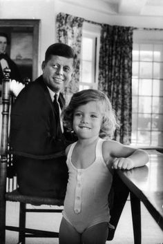 Sen. John Kennedy with his young daughter Caroline at home after he was named the Democratic Party presidential nominee in 1960.
