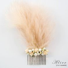 Alice Feather Hair Comb  http://www.brittenweddings.co.uk/shopbritten/hair-combs/alice-wedding-bridal-feather-hair-comb/