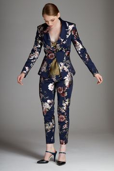 A fun twist on a classic slim fit cut suit jacket. Stand out this season with this one of a kind floral suit that has subtle metallic details. #holidayoutfit