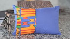 Colorful African Kente Fabric Pillow Cover. $20.00, via Etsy.