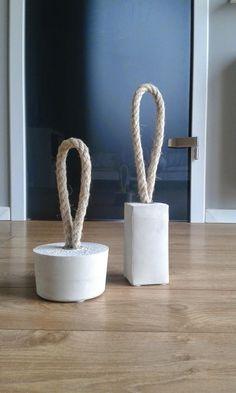 Concrete and rope door stops