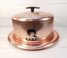 Vintage West Bend Cake Carrier  Measures 7 1/2 inches in height to the top of the handle, the plate