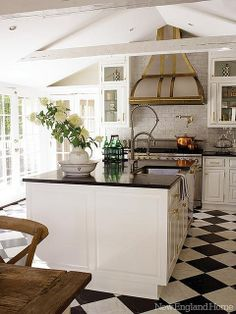 Great mix of brass and silver tones in this kitchen, complete with Black and White Floor - #New England Style