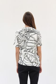 100% organic cotton jersey, hand printed Black Plants print on ivory. Uneven side hem on one side. Model is wearing size small. Made in Germany.