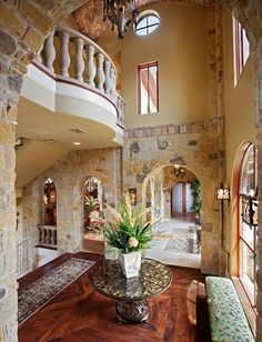 Stone work walls, arches and balcony. Interesting space.