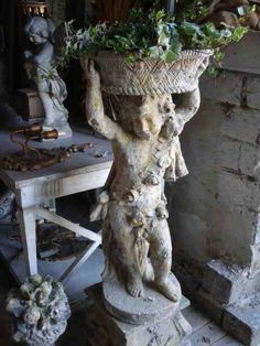 white vintage garden statue...  Would LOOOOVe to have this in my entry
