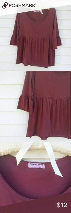 Michael Stars Baby Doll Shirt This Shirt is So Cute ! It has 3/4 Length Sleeves that Flare out from the Elbow. Raw Edge Hem and Sleeves and a Low Scoop Neck. Color is a Mauve/Berry. One Size Fits Most. Fits Like a Small or Petite Medium. Worn 2 or 3 Times. Its in Great Condition with No Flaws ! Michael Stars Tops