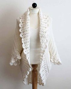Shell Edged Jacket Crochet PatternIndulge yourself with this delicately flowing crochet pattern for a sweater jacket. The lacy shell stitches around the edge gi