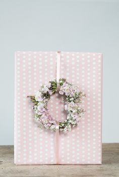 DIY gift wrapping idea. Make a beautiful flower wreath from garden flowers and start decorating