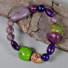 Elastic bracelet with green and purple tagua nuts, mauve and green vegetable ivory nut bracelet, eco bracelet with purple acai beads by NataliaNorenasilver on Etsy Nut Bracelet, Bangles, Bracelets, Necklaces, Women Jewelry, Unique Jewelry, Green And Purple, Mauve, Gifts For Her