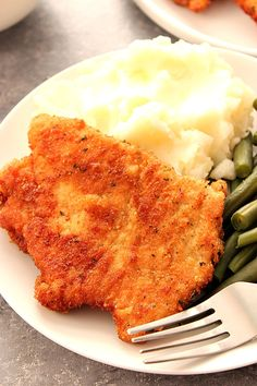 Pork Schnitzel - crispy and juicy schnitzel made with thin pork loin cutlets, lightly breaded and fried to golden perfection. Pure comfort food at it' Thin Sliced Pork Chops Recipe, Thin Pork Chops, Fried Pork Chops, Pork Loin Chops, Pork Cutlets, Baked Pork, Crispy Pork, Pork Roast, Pork Cutlet Recipes