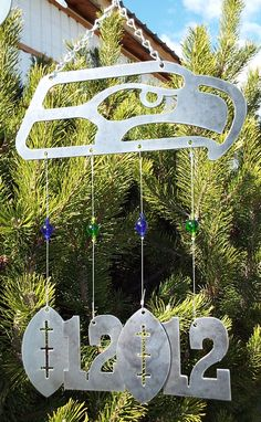 Seattle Seahawks Wind Chime - Handmade - Outdoor Decor - NFL - 12th Man - Football - Metal - Glass Beads by DJLDesigns05 on Etsy