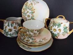 8 piece set of hand painted china.marked Hicks(artist) and MADE IN GERMANY on bottom.Creamer x with lid x they are painted on both sides saucers dessert plates 6 and 1 cup 2 painted on both sides gold trim.no chips or cracks Porcelain Ceramics, China Porcelain, Tea Sets Vintage, Vintage Items, China Tea Sets, Cup And Saucer, White Flowers, Tea Cups, Hand Painted