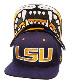 This adjustable baseball cap accommodates different head sizes and features an intimidating image beneath the brim to strike fear into the hearts of opposing teams.