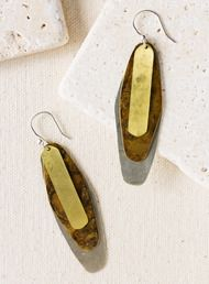 The earrings stack organic plates of shiny and oxidized mixed metals.